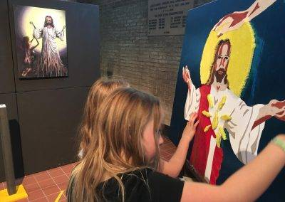Children feel Taktila illustration of Jesus during exhibition Jofke