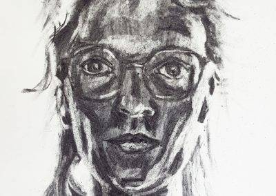 Self-portrait drawing with charcoal by Jofke